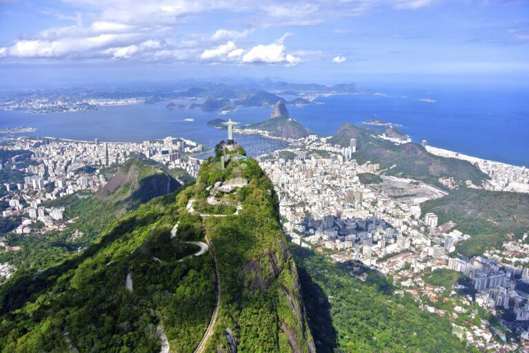 Aerial shot of the Corcovado with the Sugar Loaf Mountain in the distance in Rio de Janeiro on a luxury Brazil tour