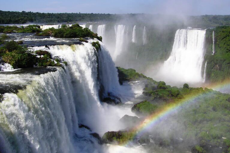 A rainbow and mist over Iguassu Falls during a private tour of Iguassu