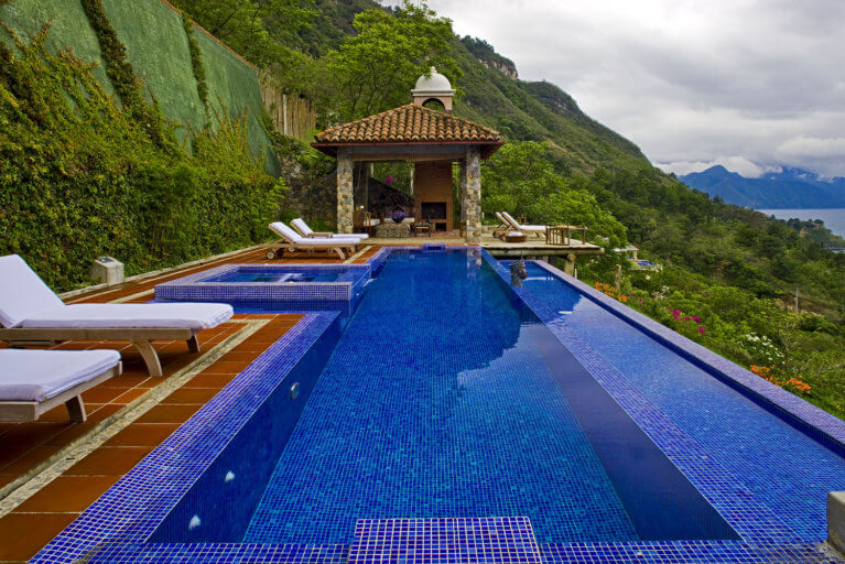 Side view of pool against greenery at Casa Palopo on a luxury Guatemala tour