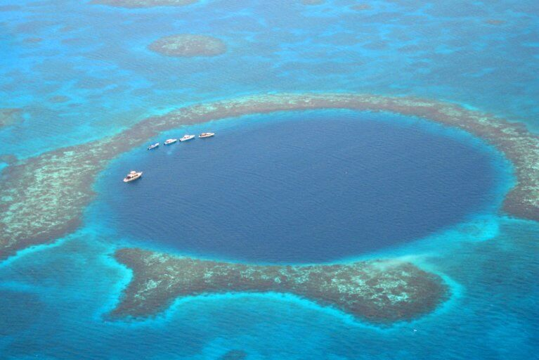 Aerial view of the Barrier Reef and private boat tour, Belize
