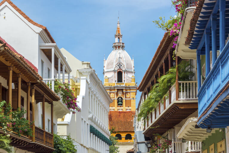 View of colorful Cartagena houses leading to the cathedral on a luxury Colombia trip