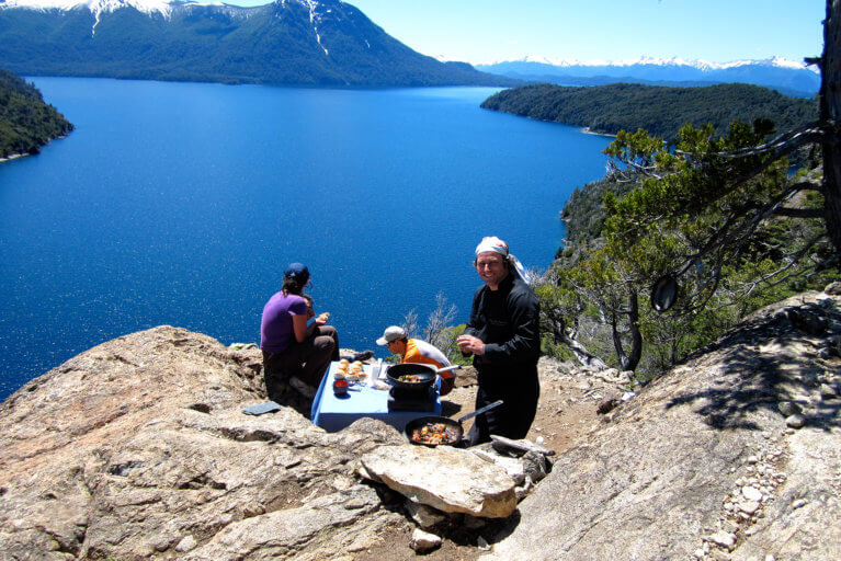 A delicious private lunch with mountain and lake views on a sunny day during a hike in Argentina's Lake District
