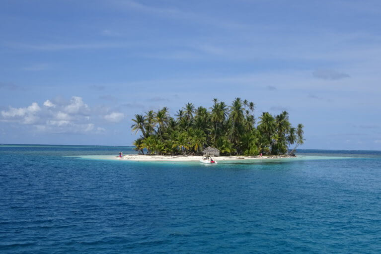 View of one of the tropical San Blas Islands in the middle of the ocean in Panama