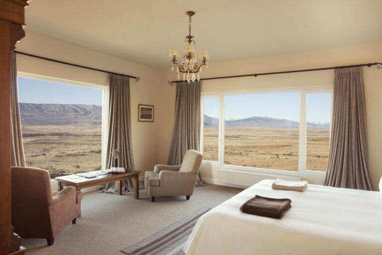 Luxury Suite at Eolo Hotel in Patagonia with views of the natural landscape outside