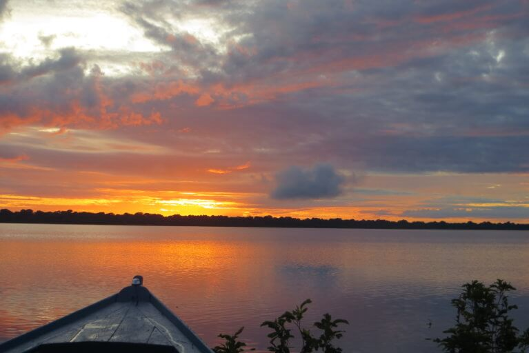 Sunset over the Amazon river from boat during a private Amazon tour