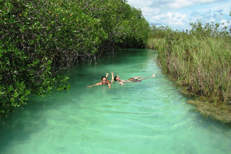Couple enjoying secret swimming spot during a private tour of the Yucatan
