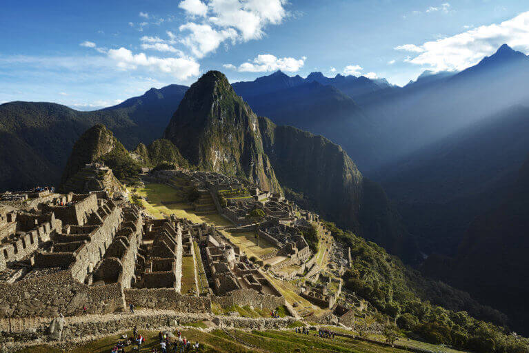 View of the ancient site of Machu Picchu on a sunny day in Peru