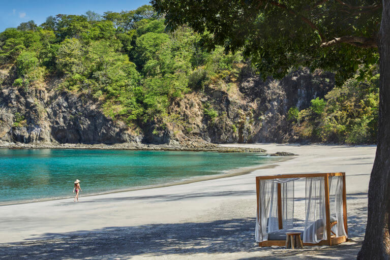 Woman enjoying private beach at the Four Seasons in Costa Rica