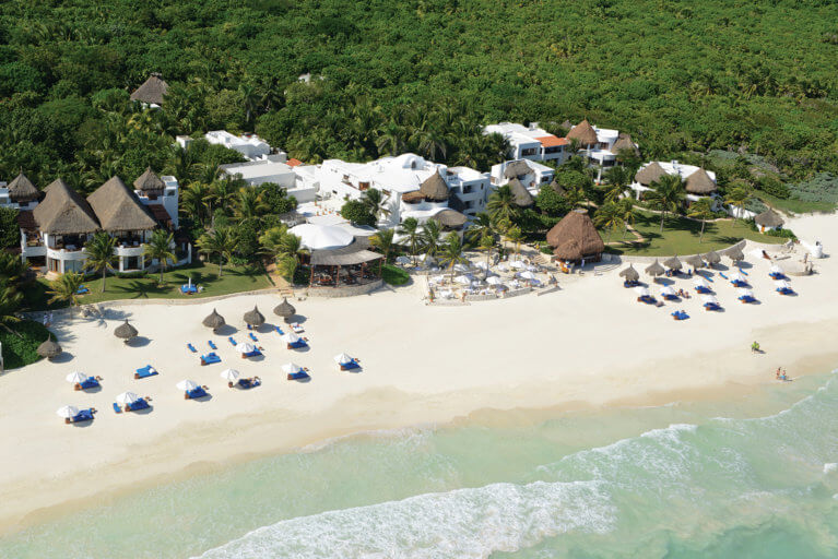 Aerial view of Belmond Maroma Resort and beach with jungle backdrop, Yucatan