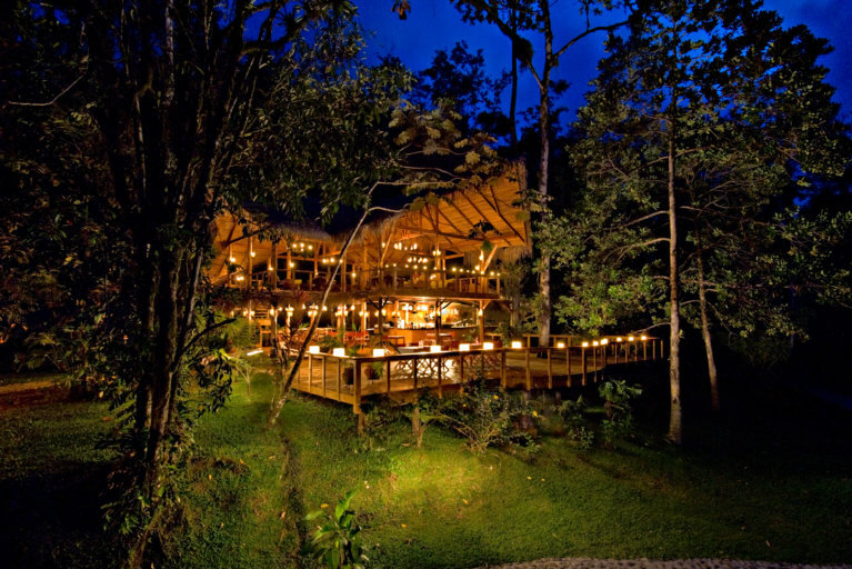 Pacuare Lodge by night all lit up on a luxury trip to Costa Rica