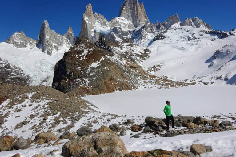 Man trekking up the snowy mountains of Patagonia on a private tour