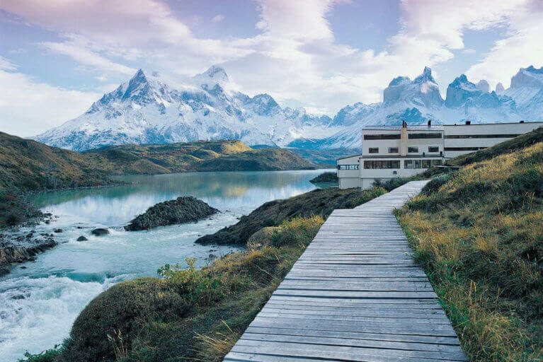 View of luxury Explora Hotel against a mountain backdrop in Patagonia