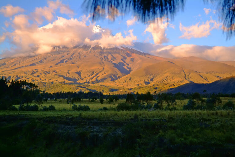 Greenery and mountain views at sunset on a private Ecuador tour to the Galapagos Islands