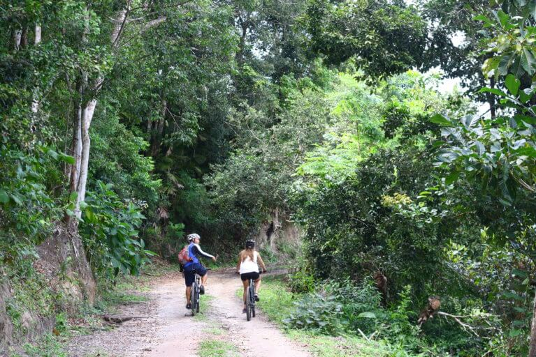 Two people on a biking excursion outside of Trancoso during luxury brazil trip