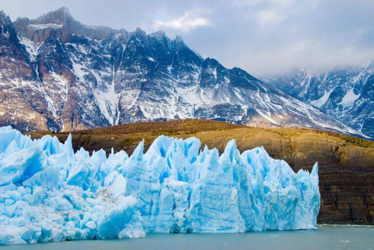 Icy blue glacier and mountains in Torres del Paine, Patagonia