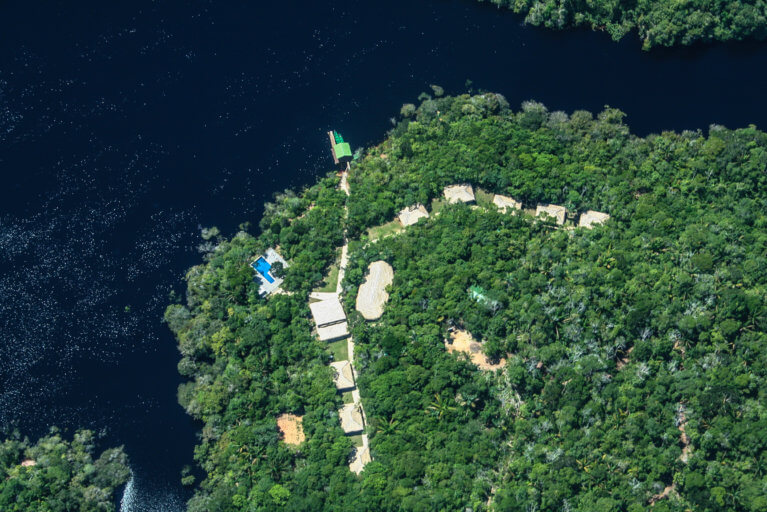 Aerial view of the Amazon rainforest and river during a luxury tour of the Amazon