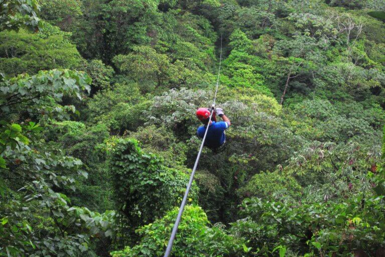 Man ziplining in rainforest during a luxury trip to Costa Rica