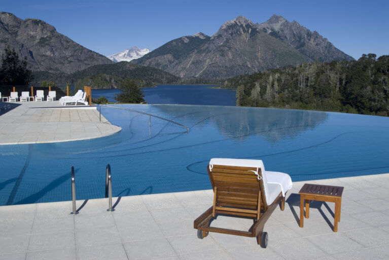 Infinity pool at the Llao Llao Hotel by day with a lake and mountain backdrop on an exclusive Argentina tour