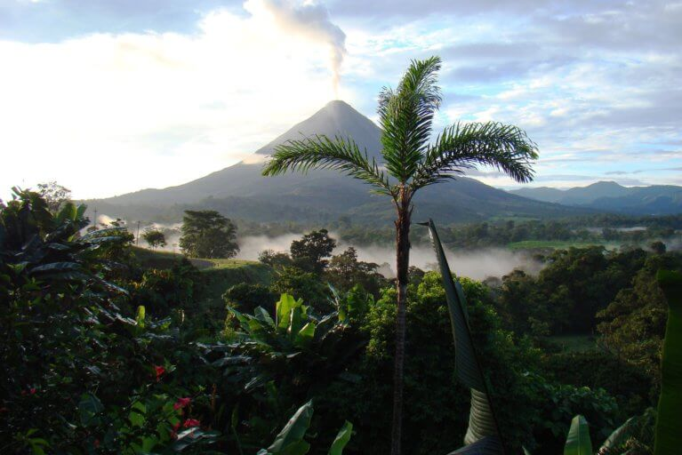 View of Arenal volcano smoking in the distance during luxury tour of Costa Rica
