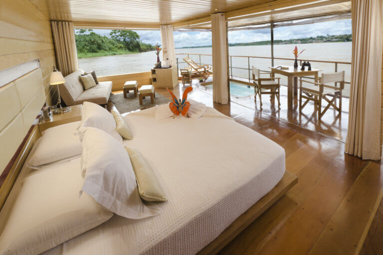 Room on a luxury Amazon charter with private terrace and views of the river