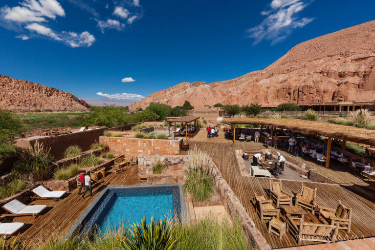 Pool and deck at Alto Atacama with mountain backdrop during luxury tour of Chile