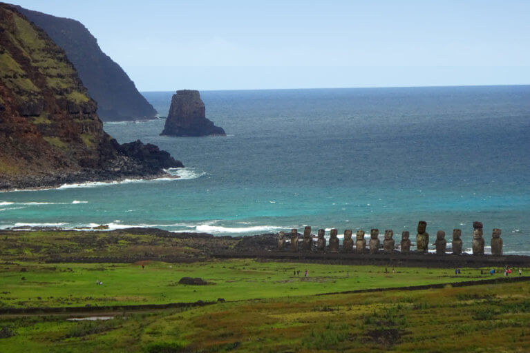 Line of Moai statues against backdrop of the sea on Easter Island during a luxury trip to Chile