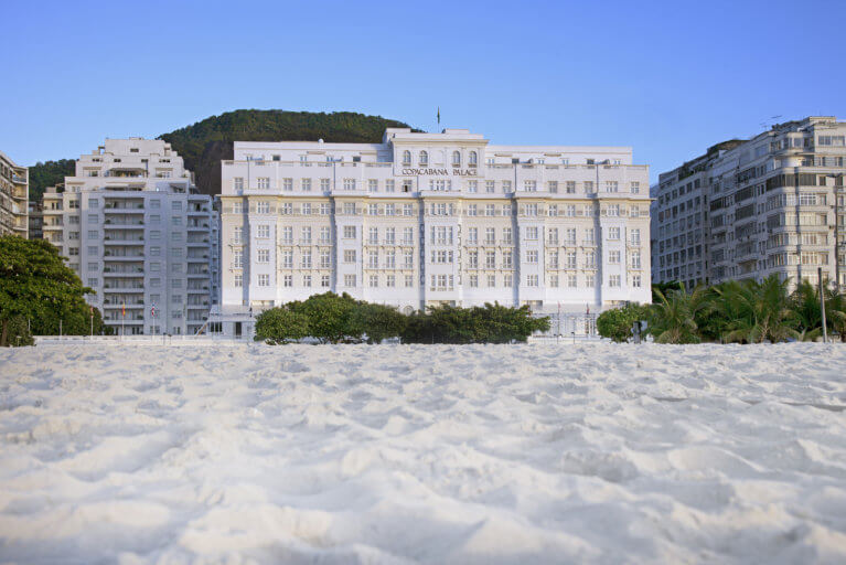 Facade of the luxurious Copacabana Palace Hotel in Rio as seen from Copacabana Beach during a luxury Brazil tour