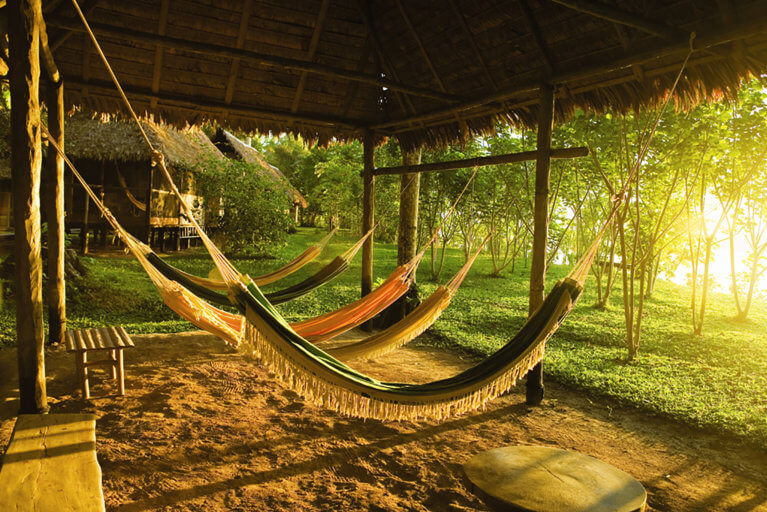 Hammocks at sunset at the Reserva Amazonica during a luxury Amazon trip