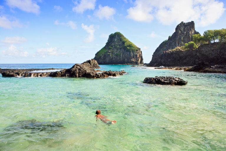 Boy snorkelling in clear waters of Fernando de Noronha during luxury Brazil tour