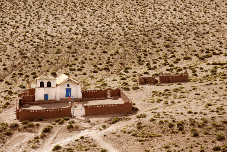 Aerial view of small church in the middle of Atacama Desert during luxury trip to Chile