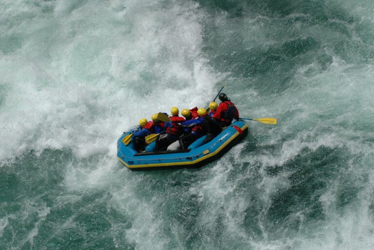 A small group of people on a private white water rafting tour on Manso River in Argentina's Lake District