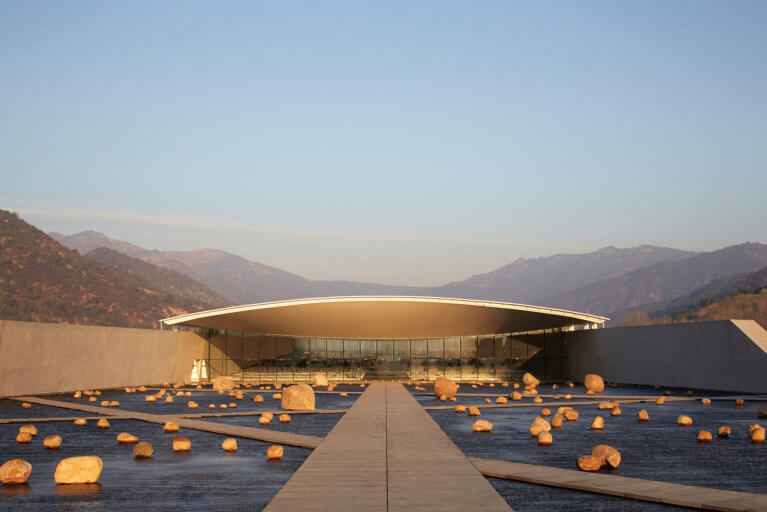 Futuristic architecture at the Vik winery with mountain backdrop in Chile's wine region during a private Chile tour