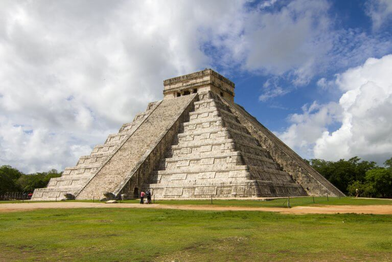Temple of Kukulcan against blue sky within the Chichen Itza archaeological site during a private Yucatan tour