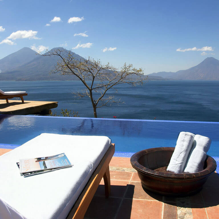 View of outdoor pool and volcano during luxury Guatemala tour