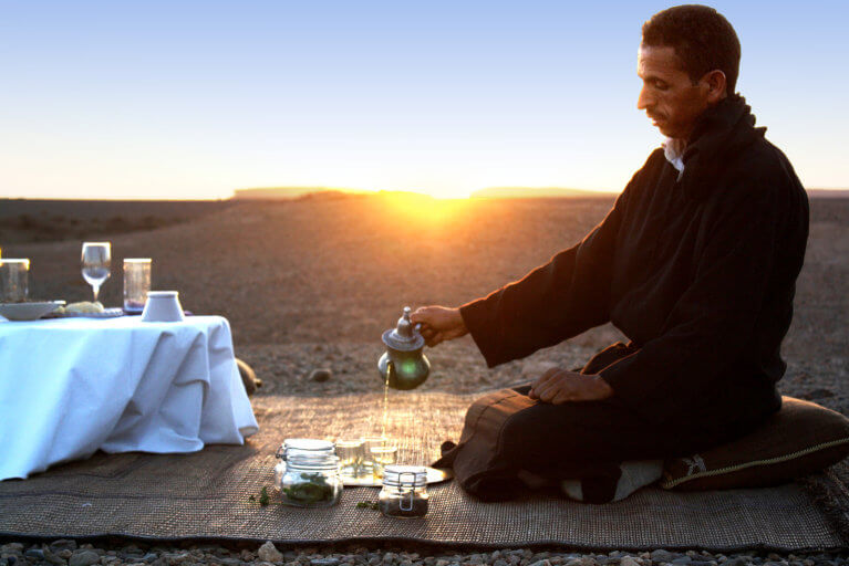 Moroccan man conducting a private tea ceremony during a luxury Morocco tour