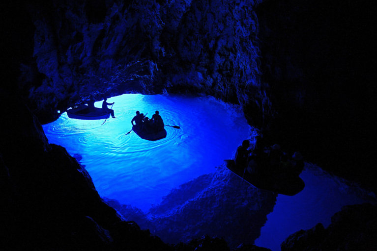 Kayaking in Blue Grotto during private Croatia tour