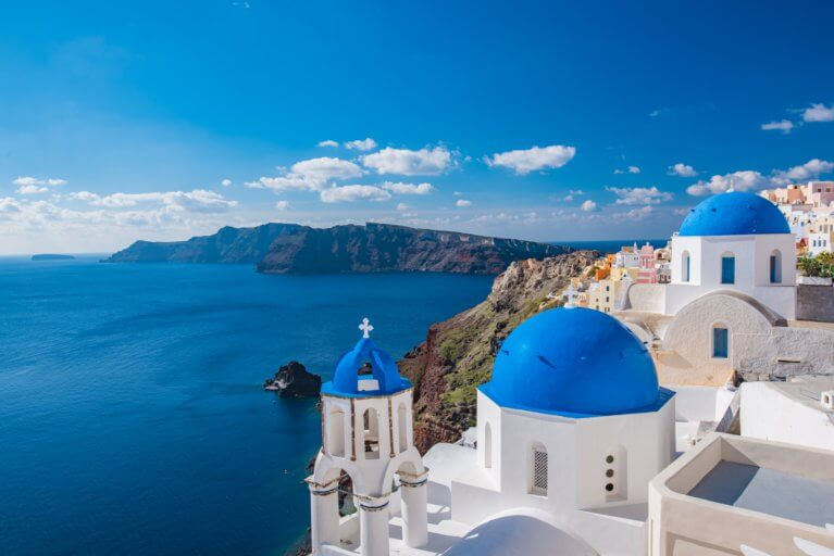 Views of Santorini's blue domed buildings and the sea