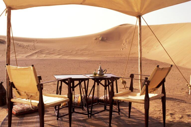 Set up at private desert camp in Sahara Desert during luxury Morocco tour