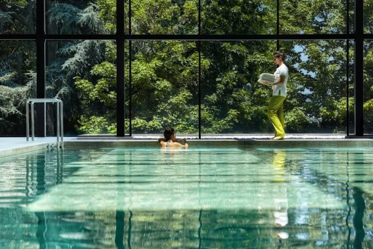 Girl enjoying pool at Six Senses spa in the Douro Valley on a luxury Portugal tour