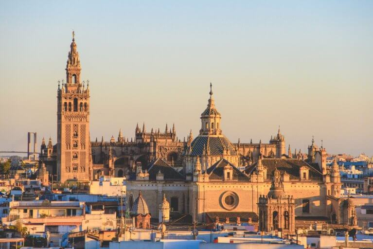 Skyscape of Seville and its famous cathedral at sunset during a luxury Andalusia trip