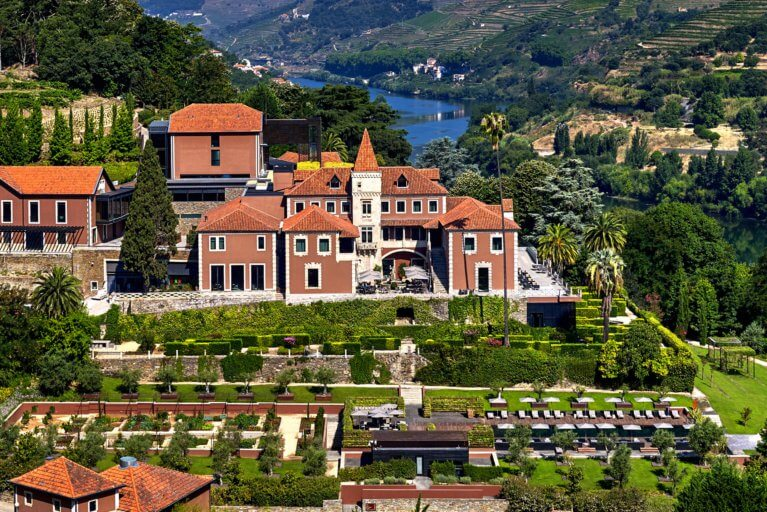 Aerial view of Six Senses Hotel among vineyards and hills during a luxury Portugal trip