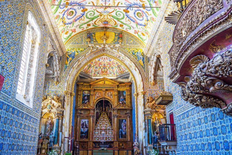 Golden interior of Coimbra University's St Michaels Chapel during a private Portugal tour