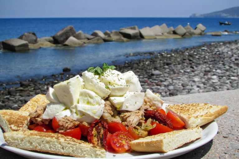 Close up of traditional Pane Cunzato lunch and sea views during private Sicily tour