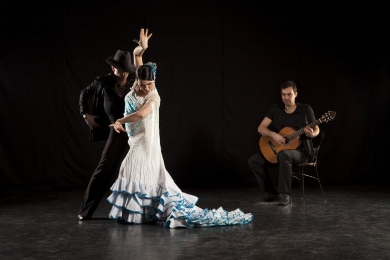 Two flamenco dancers and a flamenco musician during a private flamenco show in Andalusia