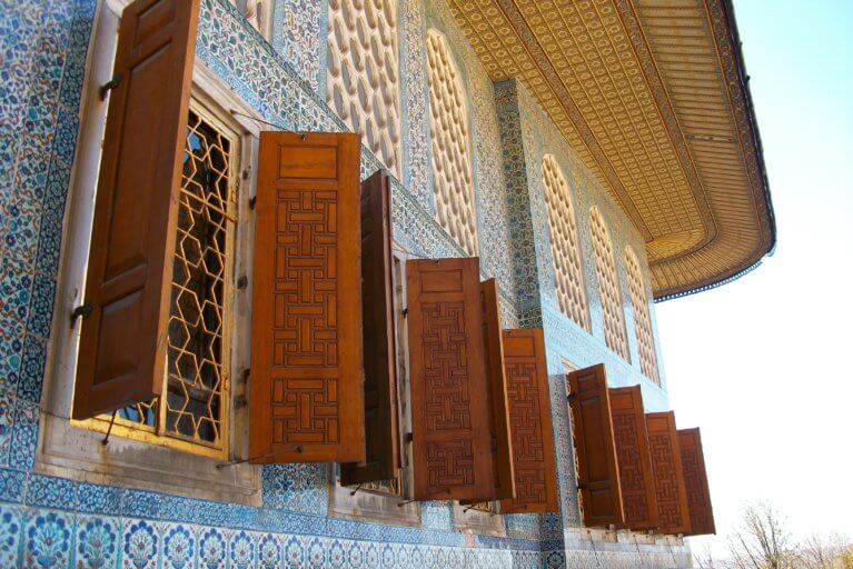 Close up of windows and colorful tiles displaying traditional architecture of Turkey during insider access tour of Turkey