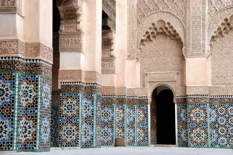 Intircate architectural detail of Ali Ben Youssef Madrassa in Marrakesh during a luxury Morocco trip