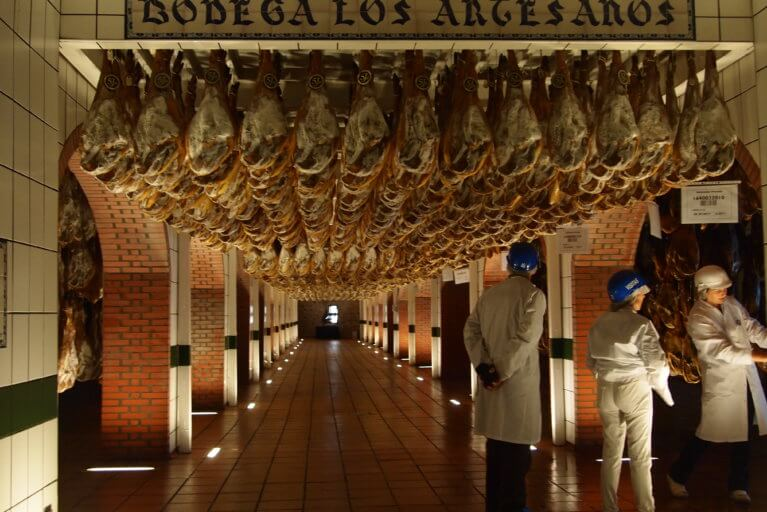 Two clients enjoying a private tour of jamon factory during a luxury trip to Spain