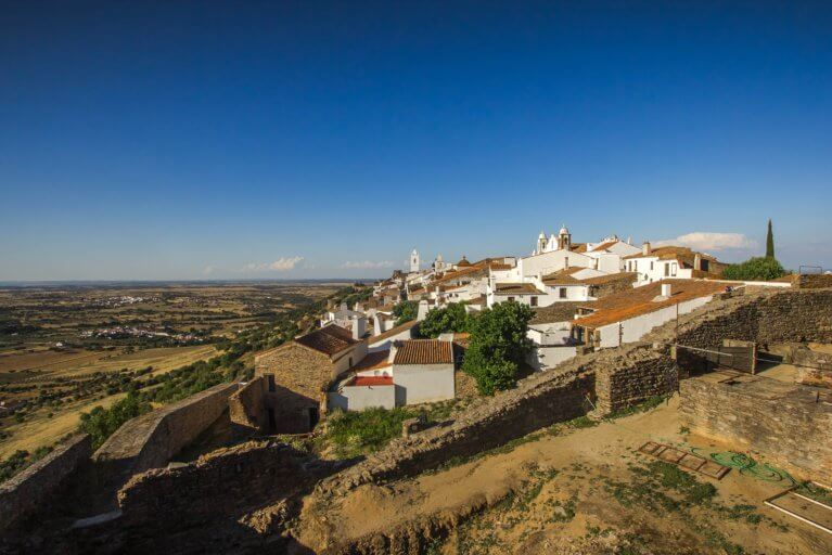 View of hilltop town of Monsaraz on a sunny day on a luxury Portugal trip