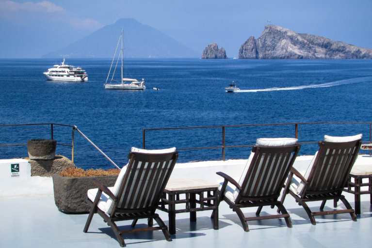 Al fresco lunch with sea views in Panarea during luxury Sicily tour