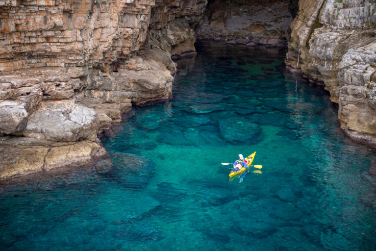 Aerial view of man kayaking in Dubrovnik caves during private Croatia tour